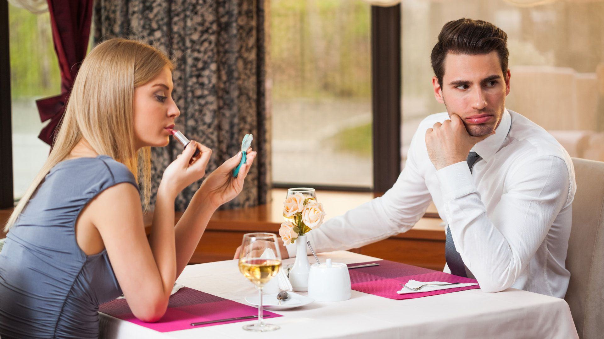 Young couple is getting bored and on first date